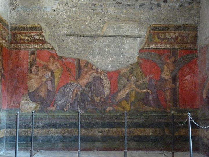 Colourful mural decoration in one of the better preserved villas