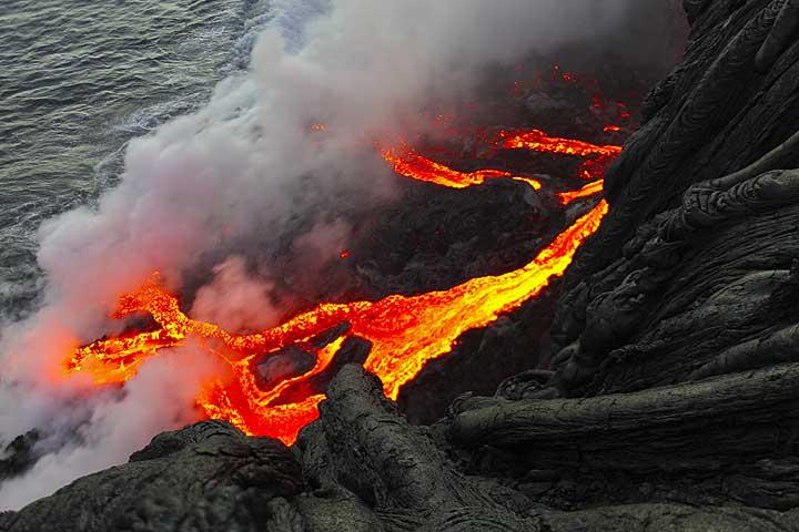 Lava flows into the ocean