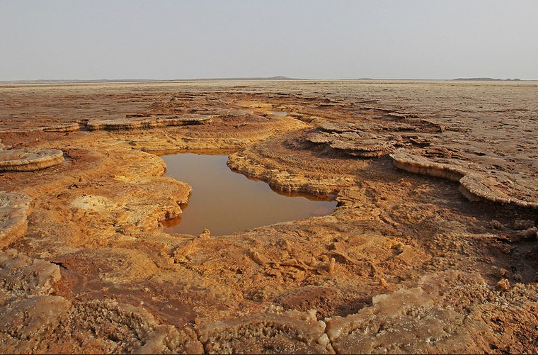 One of many small acid pools amidst the red-brownish layers of salt deposits (Jay Ramji - February 2016)