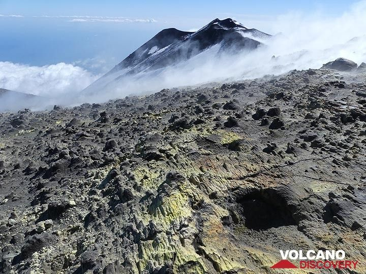 View from the thick sulfur layer with thin ash cover on the east rim of the Voragine crater (foreground) towards the SE crater complex (background). (Photo: Ingrid Smet)