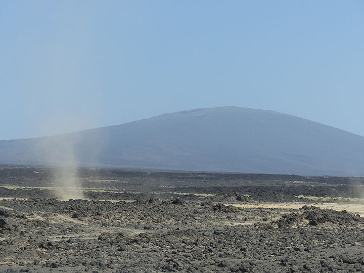 During the off-road drive across a sandy desert with dark lava flows dust devils appear frequently in the landscape (November 2015 - Ingrid Smet)