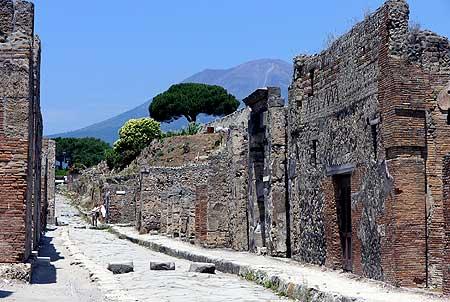Ruins of Pompeii and Vesuvius volcano in the background