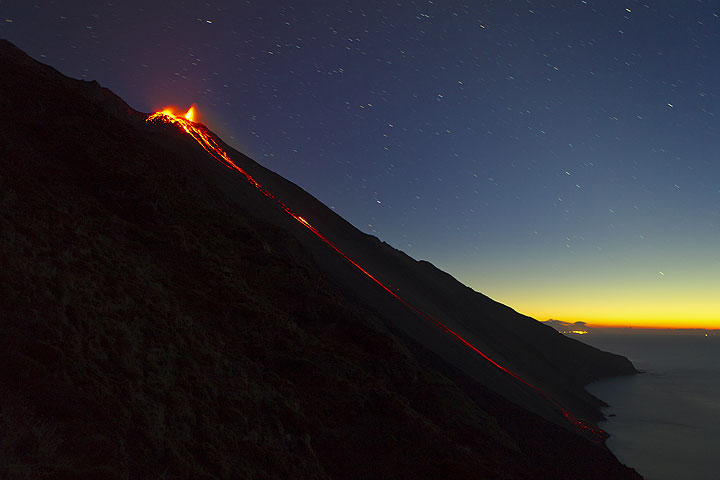 Activitiy at the summit craters and trails of glowing bombs rolling down the Sciara del Fuoco