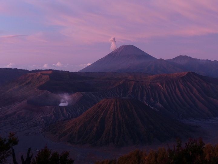 Small eruption from Semeru (background) shortly before sunrise