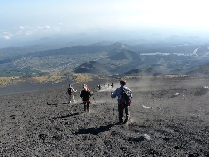 Descend through a volcanic moonscape of ash, scoria and cinder cones back to the hotel
