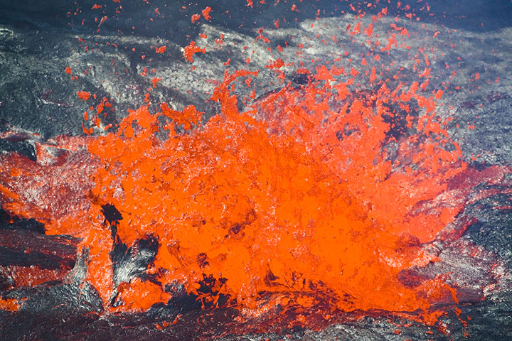 Exploding lava bubble on the lava lake of Erta Ale volcano