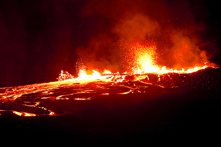 Nighttime impression of lava flow and spattering from the overflowing lava lake (Dec 2010; image: Tom Pfeiffer)