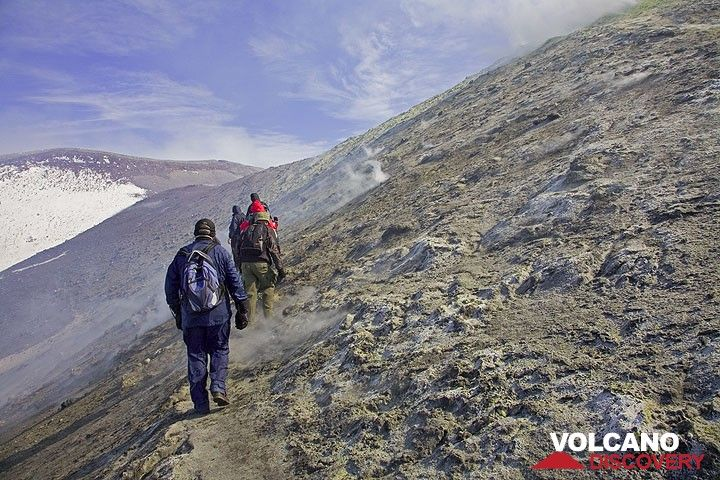 We have passed the fumaroles and are now heading towards the northeast crater, visible in the background. (c)