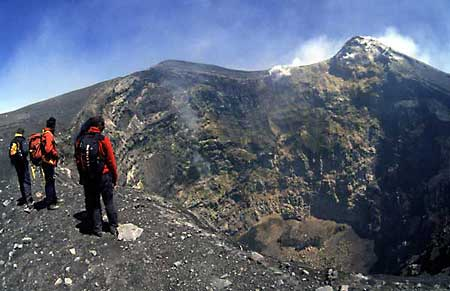 Standing the crater of Bocca Nuova, one of Etna's summit craters