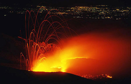 Etna in eruption, lights of Catania in the background