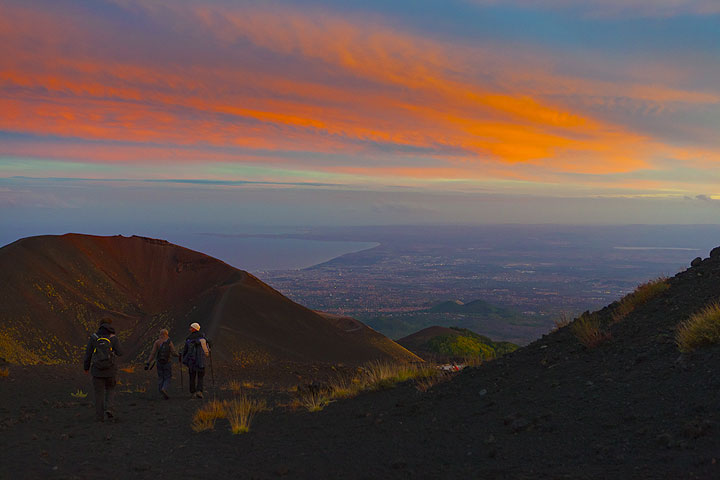 Sunset view across Etna´s lower slopes with cinder cones and the Bay of Catania in the background