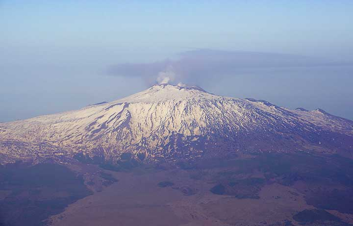 Snow-covered Etna volcano seen from the West