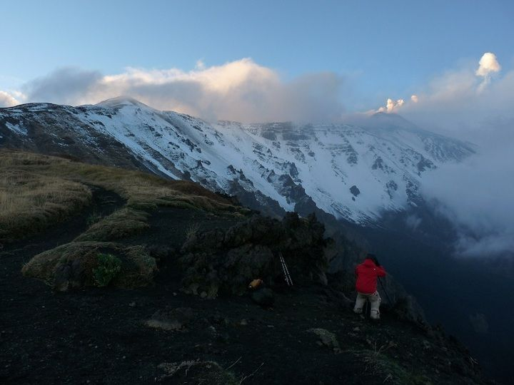 First snow covers the upper slopes and summit area of Mt Etna