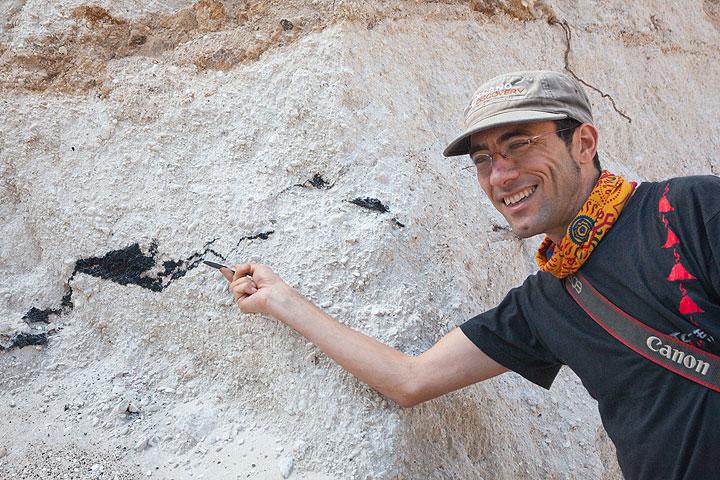 Yashmin explaining charred wood fragments in the ash deposit