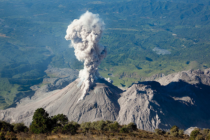 Ash eruption with small pyroclastic flows on Santiaguito lava dome