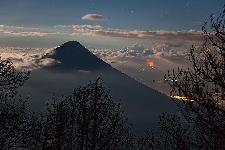 Agua and Pacaya volcano with its lava flows at night