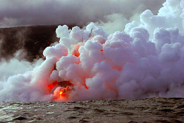 The interaction between the hot lava and cold ocean water creates lots of steam and explosions