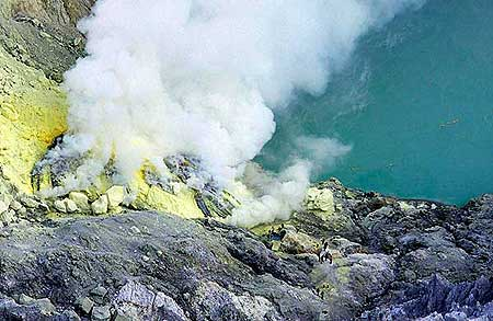Sulphur deposits and acid crater lake at Ijen
