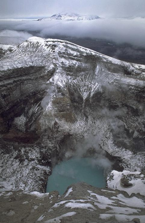 The second and active summit crater of Gorely, with a boiling and acid green lake (photo: Marco Fulle)