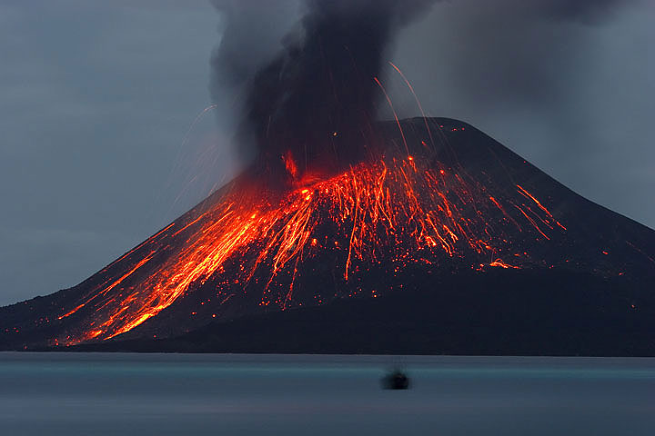 Incandescent lava bombs can be seen rolling down Krakatau's slopes at night