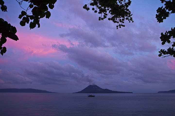 The active volcano seen from the beach of a neighbouring island at dusk