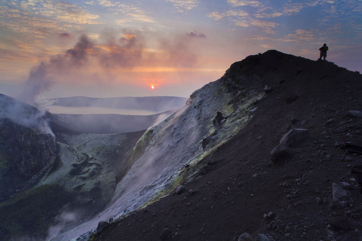 Watching the sunrise from the crater rim of Anak Krakatau's summit