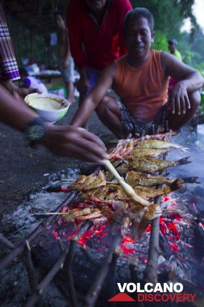 Grilling freshly caught fish for dinner