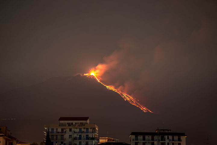 Etna´s eruption and lava flow seen from Catania mid June 2014