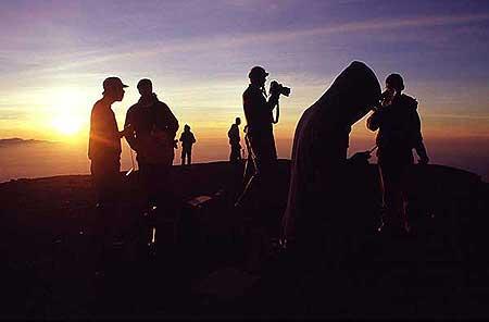 Group on Semeru's summit at sunrise