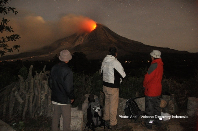 Group observing Sinabung at night