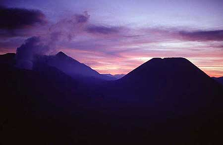 Sunset over the Tengger caldera with smoking Bromo (left) and the silhouette of Batok volcano (right)