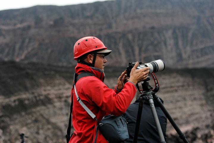 Volcanologist observing Yasur volcano