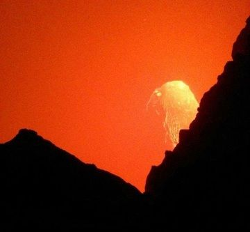 Peak down to the actively churning lava lake in the south crater of Erta Ale's summit caldera (image: Simeon B)