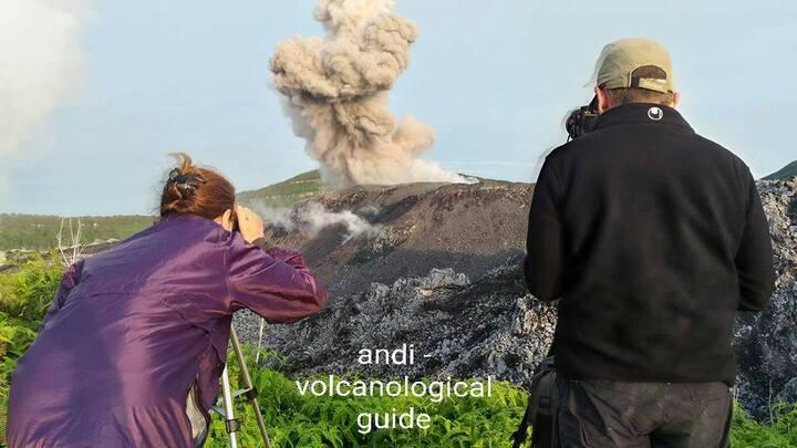 Joy and Thomas photographing an explosion at Ibu volcano (photo - Andi)