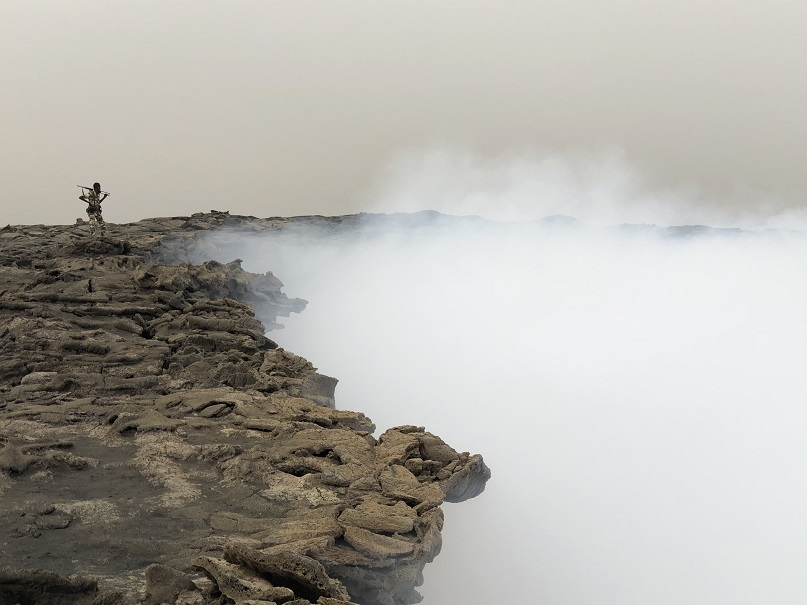 Standing on the rim of the south crater in Erta Ale's summit caldera (image: Rebecca W)