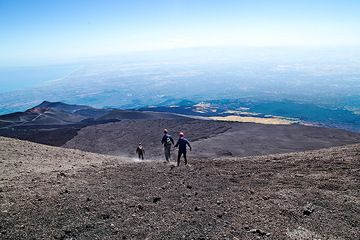 Hand in hand walking down Etna's Summit Craters.