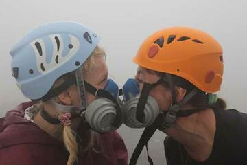 Larissa & Yulia wearing helmets and gas masks on Ambrym