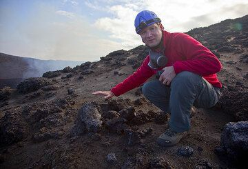 Ronny at a freshly ejected lava bomb that is still glowing inside...