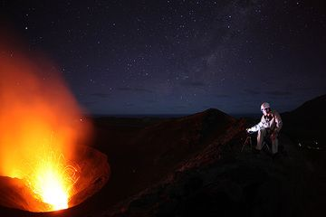 Guy watching eruptions at Yasur volcano