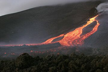 A lava flow is the result of an effusive eruptions (here Mt. Etna in Nov 2006)