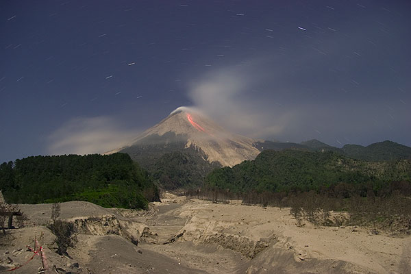 Merapi seen from the area of Kaliadem with the fresh deposits of a pyroclastic flow (June 06) in the foreground. This flow killed two people trapped inside a bunker that became buried under the hot deposit.