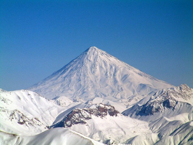 Conical snow-capped Damavand volcano is the highest volcano in the Middle East. It towers dramatically 70 km to the NE above Iran's capital city of Tehran. Activity at the 5670-m-high stratovolcano has been dominated by lava effusion. Young lava flows erupted from the summit vent blanket the western side of the volcano, and the youngest dated lava flows were erupted about 7000 years ago. Photo by Arad Mojtahedi, 2006 (http://en.wikipedia.org/wiki/Image:Damavand_in_winter.jpg)
