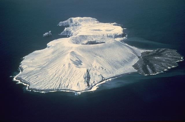 Bárcena volcano here from the SW in March 1955. The tuff cone with the circular summit crater containing a lava dome, and the lava delta to the right formed during the 1952-53 eruption. Photo by Adrian Richards, 1955 (U.S. Navy Hydrographic Office).