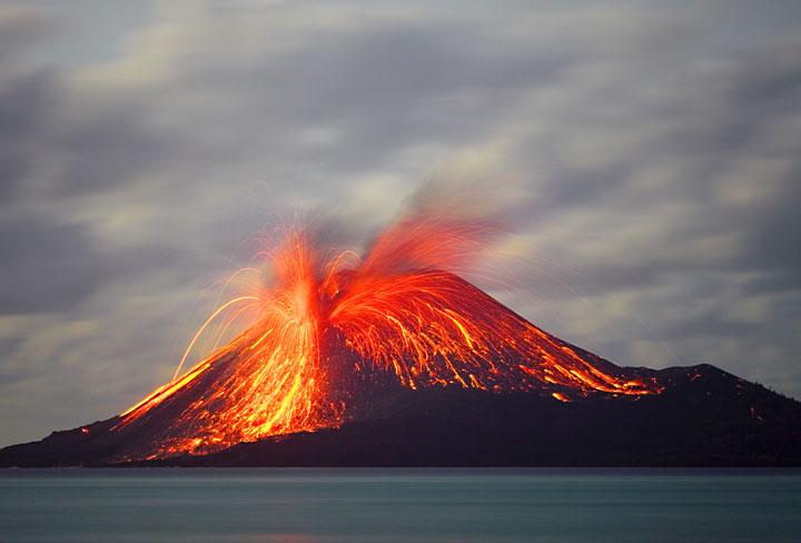 Violent eruption of Krakatau showering the summit cone with incandescent bombs.