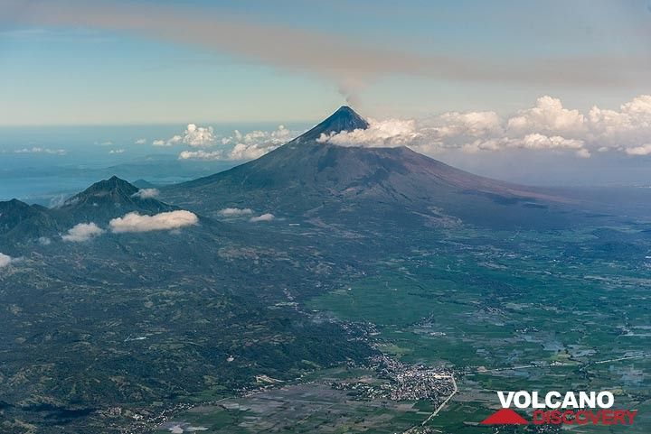 Masaraga volcano (left in the picture) with its taller and active neighbor, the Mayon stratovolcano seen during approach for Legazpi airport.