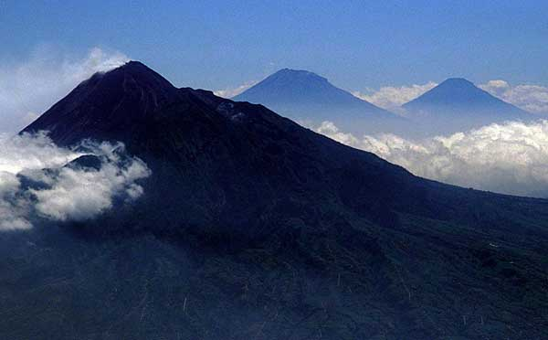 Merapi (left) with Sumbing (center) and Sundoro (right) volcanoes in Central Java seen from the east.