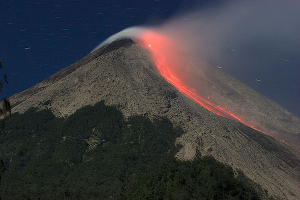 Glowing avalanches of hot rocks from the new lava dome (2006 eruption).