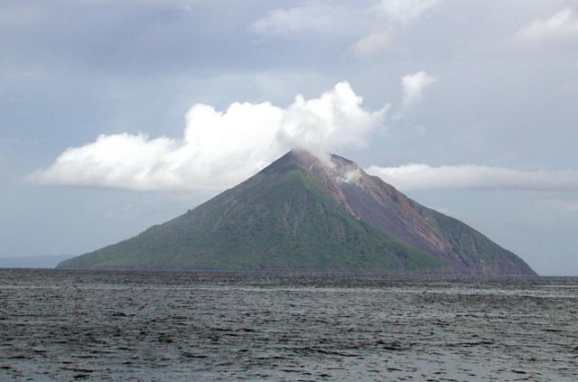"""The northern side of Tinakula volcano with its """"Sciara del Fuoco"""" below the crater at the right. Photo by Donn Tolia, 2002 (Geological Survey of the Solomon Islands, courtesy of CSIRO)"""